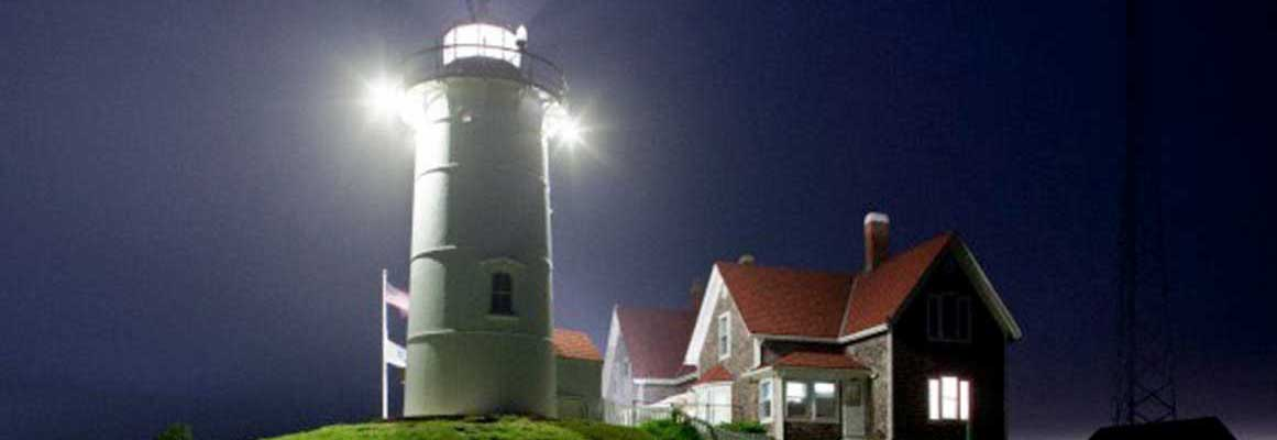The lighthouse at night will feel secure with an automated system from Cape Cod Alarm.